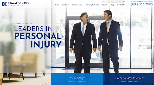 """Homepage of the website of Edwards Kirby, LLP showing two male attorneys walking side-by-side, with the message """"Leaders in Personal Injury."""""""
